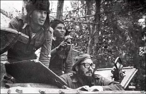 Cuban leader Fidel Castro, lower right, sits inside a tank near Playa Giron, Cuba, during the Bay of Pigs invasion