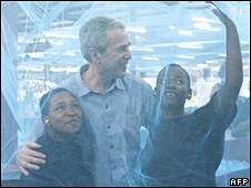 George W Bush under a mosquito bed net in Tanzania in February 2008