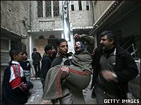 Mujer en Gaza herida por los combates