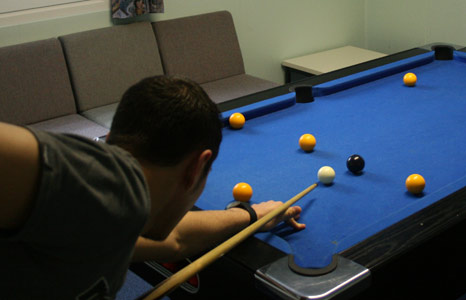 A detainee playing pool