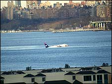 The airliner in the Hudson River shortly after the crash (image taken by BBC News website reader Nigel Baker in New York)