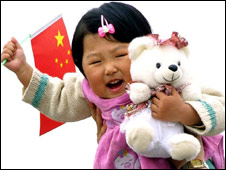 Chinese child with teddy, flag
