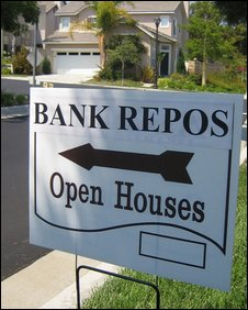 A sign advertises a bank repossessed home for sale in San Clemente, California