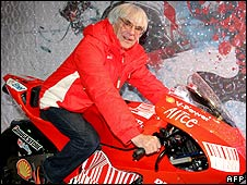 Formula One boss Bernie Ecclestone poses on a Ducati MotoGP bike at Ferrari's annual media event in Madonna di Campiglio