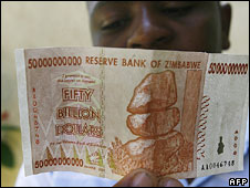 A Zimbabwean looks at a new 50 billion dollar bank note  issued on 13 January