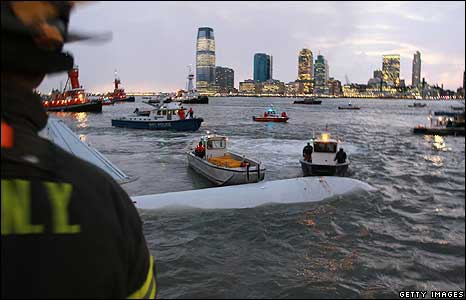 A US Airways plane floats in the Hudson River surrounded by rescue boats