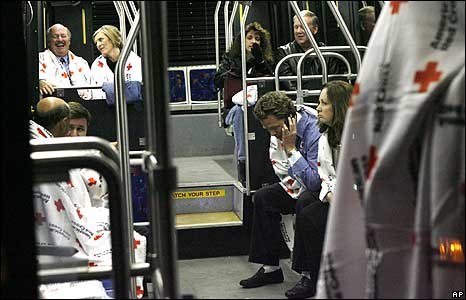 Survivors wait on a bus
