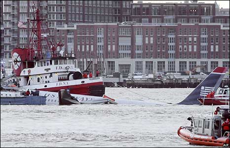 The Airbus 320 being towed in the Hudson River