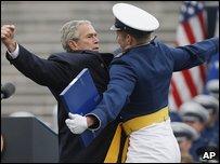 President Bush and an American serviceman