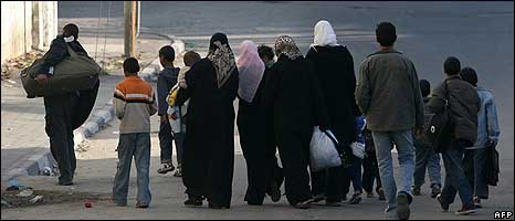 Palestinian families fleeing their homes