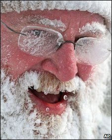 A man's face is covered with snow in South Bend, Indiana, US, on 15 January 2009