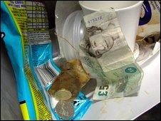 Cash in a bin
