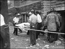 Ambulance attendants carry the body of a girl killed in a bombing at the 16th Street Baptist Church in Birmingham, Alabama, on 16 September, 1963