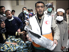 A Palestinian medic holds the remains of an Israeli shell after it hit Gaza City�s al-Quds hospital