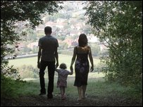 Mother, father and child in silhouette