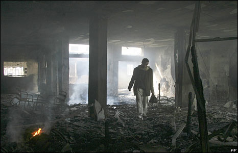 A Palestinian man inspects the damage to the al-Quds hospital in Gaza City