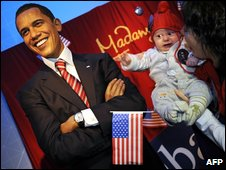 Waxwork of Obama, with teary baby