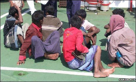 Indian coastguards with migrants who washed up on the Andaman Islands
