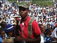 An armed man at the stadium where crowds gathered in Mogadishu