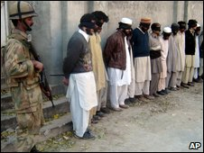 Soldier with suspected militants in Swat