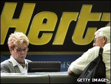 A Hertz worker assists a customer at Chicago airport