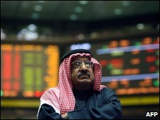A trader at Kuwait City's stock exchange, 8 January