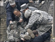 A US soldier is taken away after a blast in Kabul, Afghanistan, on Saturday 17 January 2009