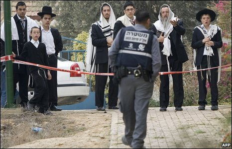 Ultra-Orthodox Jews look at the damages at a local synagogue which hit by a rocket from Gaza north of Beersheva, on January 17, 2009