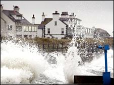 Waves lash the sea wall in Trearddur, near Holyhead, at high tide on March 10, 2008