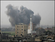 Smoke rises from the Rafah refugee camp after an Israeli missile strike on 17 January 2009