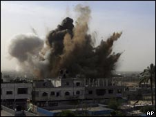 An explosion is seen where the Israeli military is bombing an area around alleged smuggling tunnels in Rafah p on 14 January