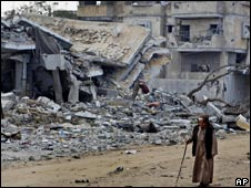 Man walks down a destroyed street in the Salahaddin street area of Rafah
