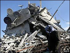 A Palestinian walks past a destroyed building in Beit Lahiya in northern Gaza