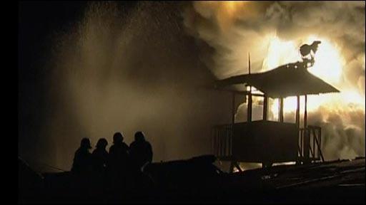 Firefighters battle a blaze at a fuel storage depot in Jakarta, Indonesia