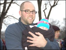 James Purse and his baby daughter at the We Are One concert in Washington, 18 January.