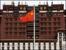A Chinese flag flies in front of the Potala Palace in Lhasa