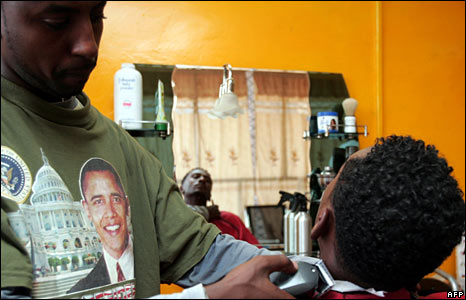 A Sudanese barber, wearing a Barack Obama T-shirt, in the Khartoum salon named after the US President-elect. (17 January, 2009)