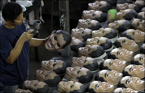 A worker cleans Barack Obama masks at a factory in Rio de Janeiro, Brazil. (16 January 2009)