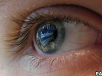 Eye reflecting Facebook logo