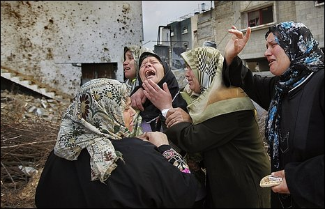 Palestinian woman grieves in Beit Lahiya