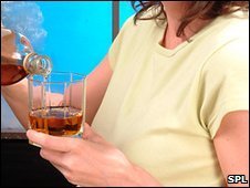 Pregnant woman pouring a drink