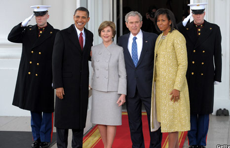 George and Laura Bush with Barack and Michelle Obama
