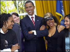 Waxwork of Barack Obama surrounded by tourists