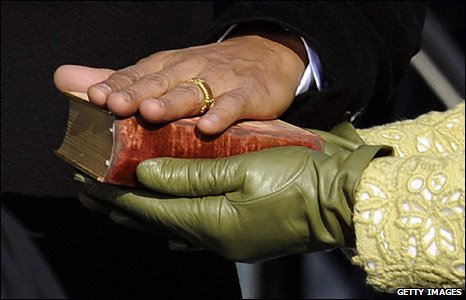 Barack Obama swears on the Lincoln Bible, held by Michelle Obama, in Washington DC