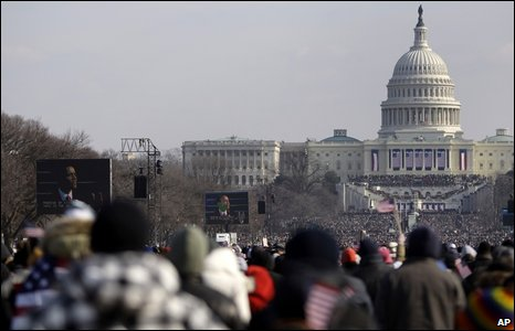 President Barack Obama is seen on the screen as he delivers his speech over a packed National Mall in Washington