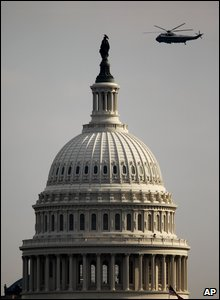 A Marine Corps' helicopter carrying former President flies past the U.S. Capitol for the final time en route to Andrews Air Force Base.