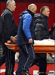 Man Utd midfielder Anderson is stretchered off