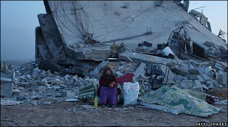 A Palestinian sits next to a destroyed house in Gaza. Photo: 20 January 2009