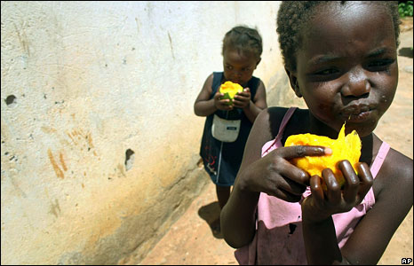 Girls eating mangoes in Harare