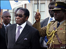 Robert Mugabe (left)